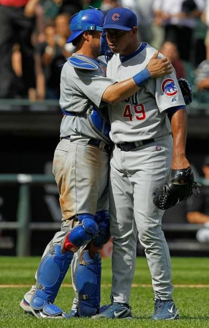 Carlos Marmol is congratulated by Geovany Soto after save.JPG
