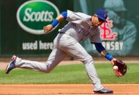 Aramis Ramirez glides to his left to field a ground ball.JPG