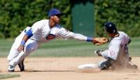 Starlin Castro tries to tag out Carlos Beltran.JPG