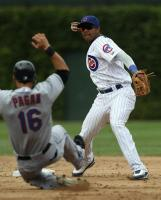 Starlin Castro throws the ball to first base.JPG