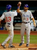 Starlin Castro high fives Blake DeWitt.JPG