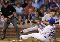 Starlin Castro slides into third base vs the Giants.JPG