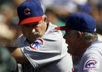 first-base-coach-matt-sinatro ou-pinilla-capt. .cubs_rockies_baseball_dxf110.jpg