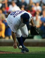 ryan dempster fields ground ball with bare hand.jpg